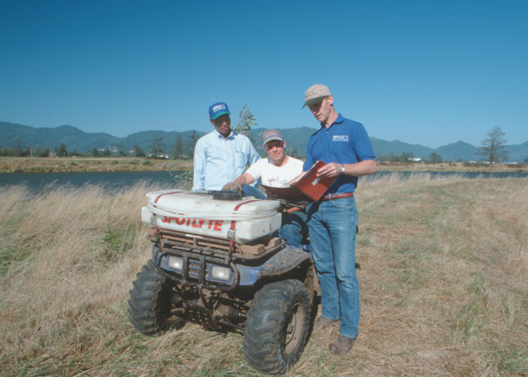 The NRCS helping a private landowner with a conservation plan along the Trask River, Oregon.